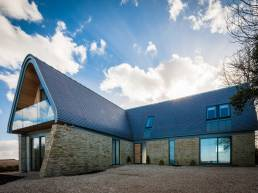 Exterior of a home in the Cotswolds designed by Adrian James Architects