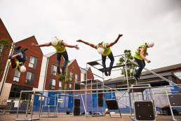 Justice in Motion performing 'On Edge', a play combining parkour dance with acting