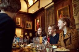 Students in the dining hall at Lincoln College in Oxford