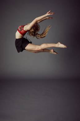 Mini Professionals Dance Academy performer leaping in the studio