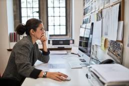 Woman working at desk at Oxford Innovation Centre