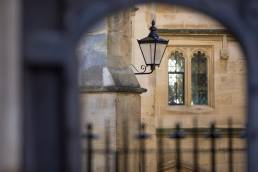 Archway, lamp and old buildings at the University of Oxford