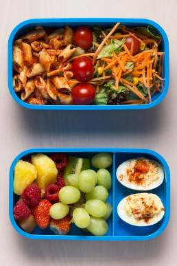 Blue lunchbox with food from above