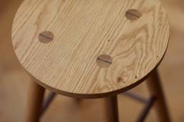 Detail of wood bar stool designed by Alexander Hay