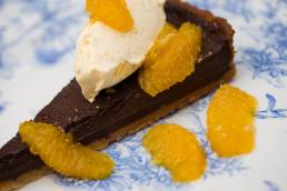 Chocolate tart with mandarin slices and clotted cream at the Perch Inn, Oxford