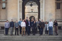 Group photograph of team from Consultant Connect on steps of the Clarendon Building in Oxford