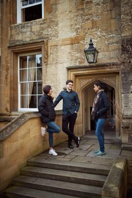 University of Oxford students chatting in college outdoor area