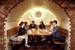 University of Oxford students relaxing in basement bar