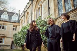 University of Oxford students from choir walking in quad