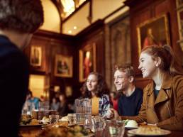 University of Oxford students having lunch in dining hall