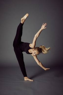 Studio dance photo of girl doing a one legged split