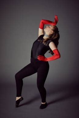 Studio dance photo of girl with red gloves