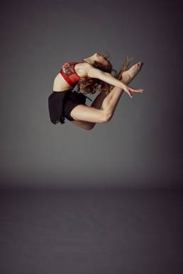 Studio dance photo of girl in mid flight