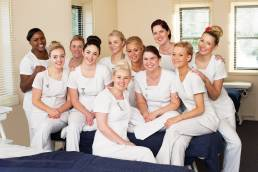 Group of beauty students posing for a photograph at their college in Witney, Oxfordshire