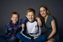 Studio portrait of three siblings