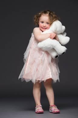 Studio portrait of three year old with polar bear teddy