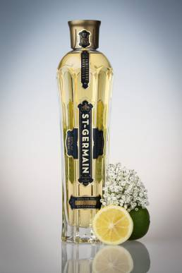 A bottle of St Germain with lime and elderflower