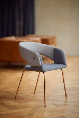Chair designed by Alexander Hay in living room