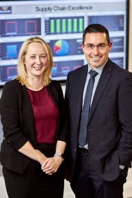Business man and business woman at Trelleborg with analysis screen in background