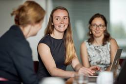 Business woman on laptop in meeting with two other women in Oxford
