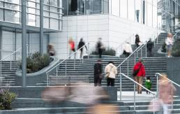 Blurry people on steps to Westfield Shopping Centre in London