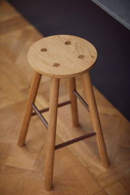 Wooden bar stool designed by Alexander Hay
