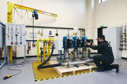 Man adjusting controls on industrial hardware