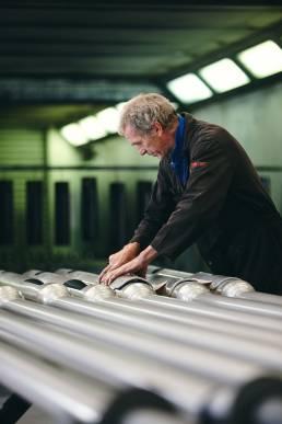 Man in factory assembling street lamps