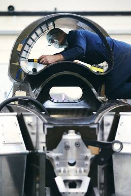Man working on the Bloodhound car while it is under construction
