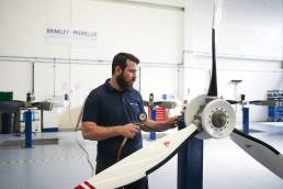 Factory worker testing propeller blades
